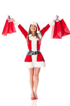 Female Santa with shopping bags - isolated over a white background photo