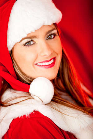 Female Santa looking happy for the Christmas holidays  photo