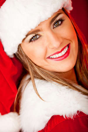 Portrait of a beautiful female Santa smiling photo