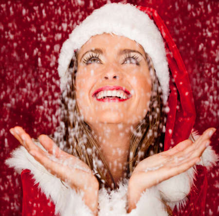 Woman with Santa outfit in a snowy Christmas  photo