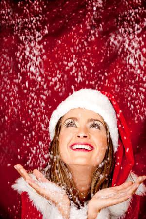 Gorgeous female Santa celebrating Christmas with snow photo