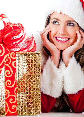 Thoughtful female Santa with Christmas presents – isolated over a white background photo