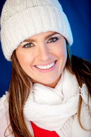 Winter girl wearing warm clothes and looking happy  photo