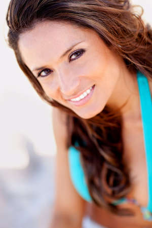 Beautiful woman portrait at the beach smiling  photo