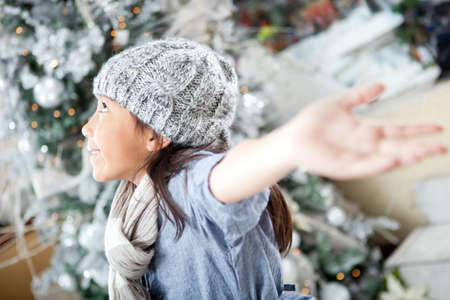 Happy winter girl with arms open excited about Christmas  photo