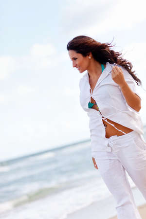 calm woman: Beautiful woman walking at a peaceful beach