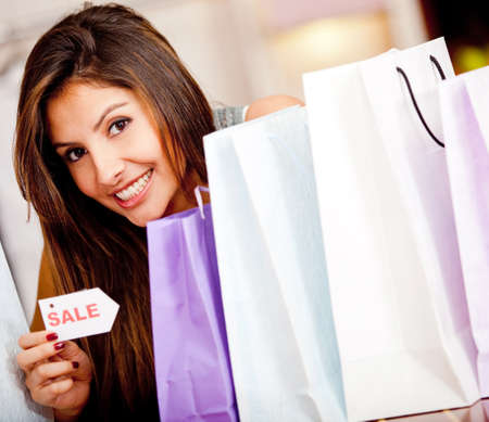 Woman shopping on sale looking happy with her purchases photo