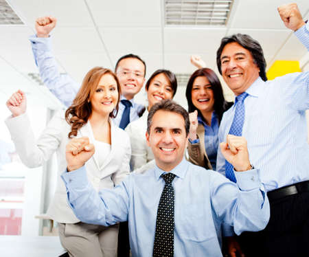 Successful business team celebrating with arms up at the office Stock Photo - 11936064