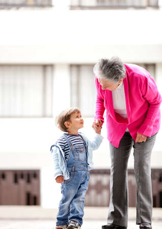 grandmother grandchild: Grandmother and children taking a walk outdoors  Stock Photo