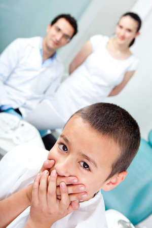 Scared boy at the dentist refusing treatment  photo