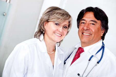 Medical team with doctors smiling and looking friendly  Stock Photo - 11936097