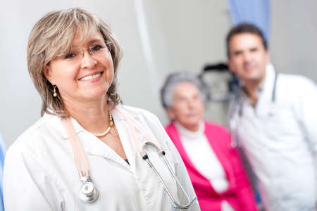 geriatrician: Geriatric female doctor smiling with an elder patient at the hospital