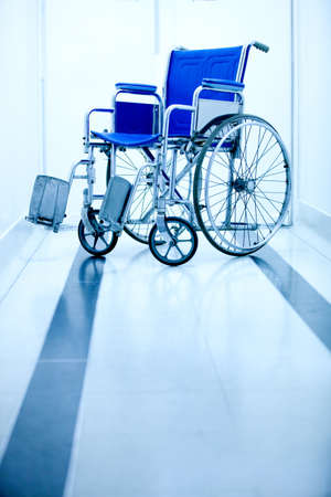 Blue wheelchair at the entrance of a hospital  photo