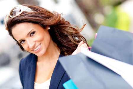 Portrait of a girl holding shopping bags and smiling photo