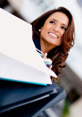 carry on bags: Beautiful shopping woman holding bags and smiling