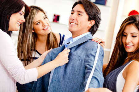 customer tailor: Man at the tailor buying a custom made suit Stock Photo
