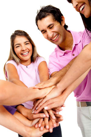 Happy group holding hands together in the center – isolated over white  photo