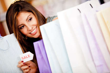 Beautiful woman shopping on sale looking excited  photo