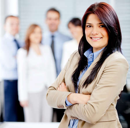 team leader: Successful business woman leading a corporate team  Stock Photo