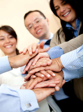 Business group with hands together - teamwork concepts