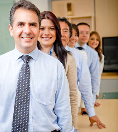 employees working: Successful business group in a row at the office