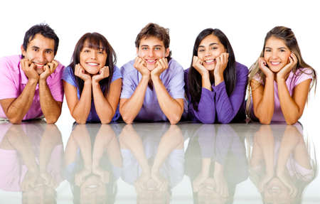 Group of friends lying on the floor smiling - isolated over white  photo