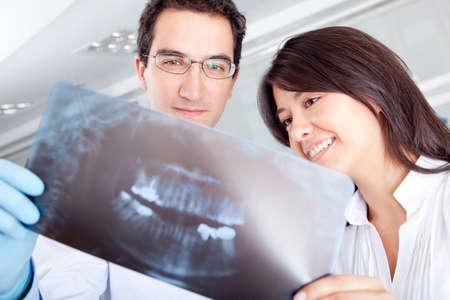 Dentist looking at an x-ray at the hospital photo