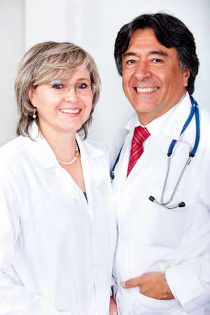 doctors smiling: Couple of friendly doctors at the hospital  Stock Photo