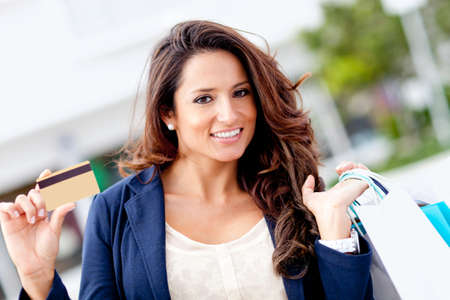 Shopping woman holding a credit or debit card  Stock Photo - 12027502