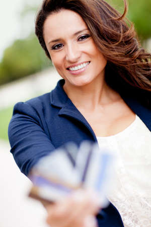 Latin woman holding credit cards - financial solutions photo