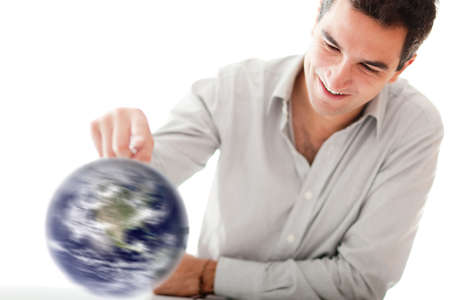Man spinning the world with his hand - isolated over a white background Stock Photo - 12057337