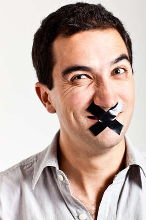 speechless: Man struggling to keep quiet with a tape in his mouth