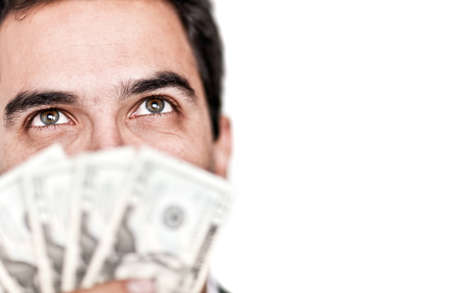 man holding money: Business man holding dollars as a fan - isolated over white  Stock Photo