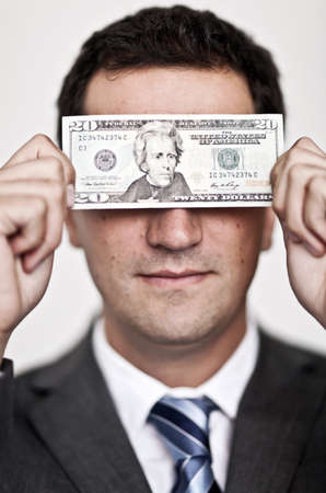 corporate greed: Business man blinded by the money - isolated over a white background Stock Photo