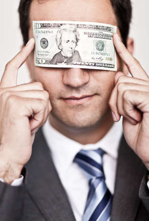 Ambitious business man blinded by the money - isolated  photo
