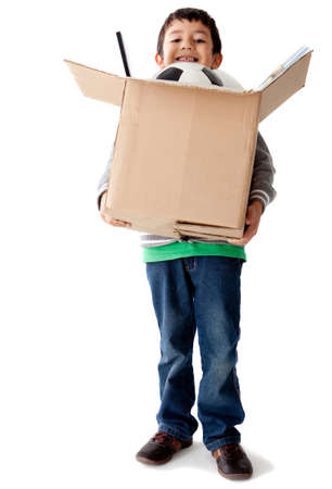 Boy holding a box with toys – isolated over a white background Stock Photo - 12057339