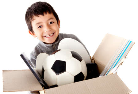 belongings: Boy moving house holding a box with his belongings - isolated white background