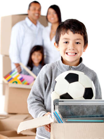 Family moving house and a boy holding a box with toys - isolated over a white background photo