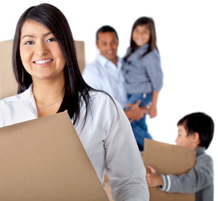 Family moving house carrying boxes - isolated over a white background Stock Photo - 12057356