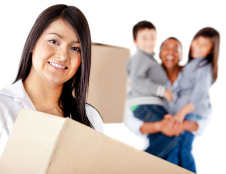 Family moving house holding boxes - isolated over a white background photo