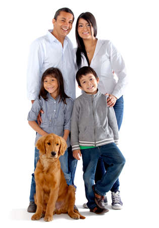 Beautiful family with a dog - isolated over a white background photo