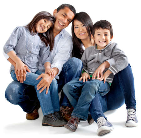 Beautiful latinamerican family - isolated over a white background Stock Photo