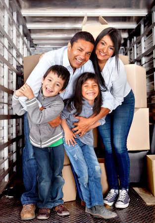 home moving: Family at the back of a moving truck ready to go to their new house