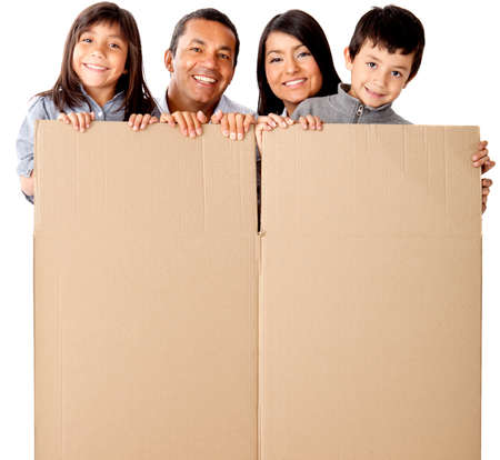 family moving house: Family packing in cardboard box for the moving - isolated over a white background Stock Photo