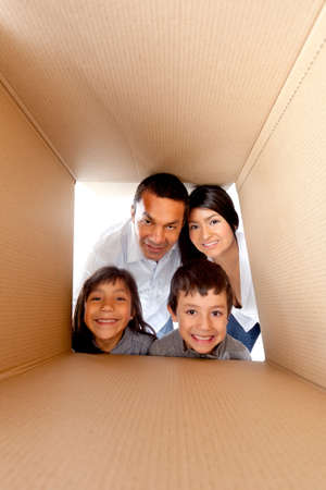 Family in a cardboard box ready for moving house photo