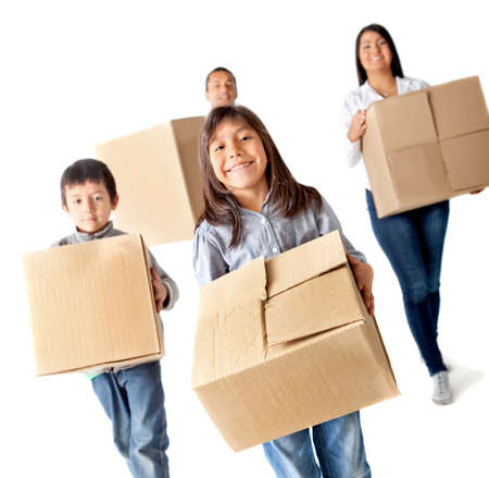 Family moving home carrying carton boxes - isolated over a white background photo