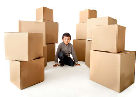 Boy with cardboard boxes - isolated over a white background photo