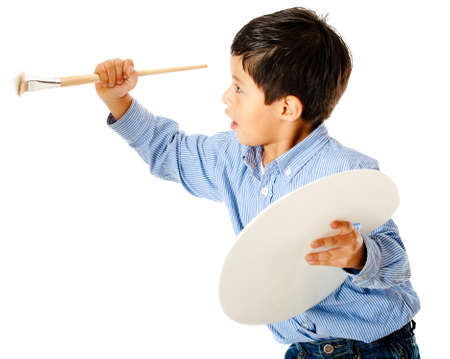 Boy holding a brush and painting on the wall Stock Photo - 12197698