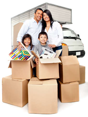 family moving house: Family moving house needing the truck services to carry boxes  Stock Photo