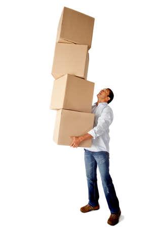 cajas de carton: Hombre transportando pesadas cajas de cart�n - aislados en un fondo blanco Foto de archivo